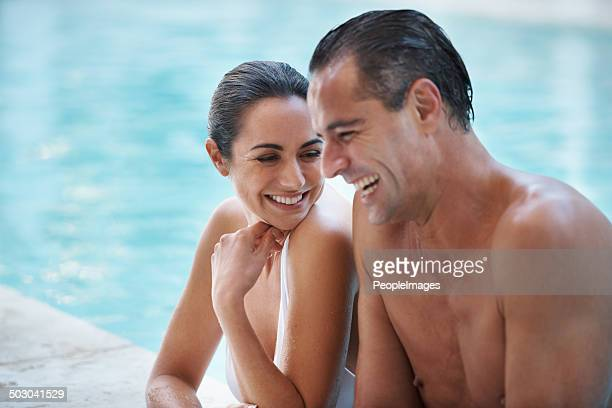 laughter and leisure - poolside stock pictures, royalty-free photos & images