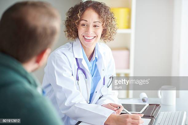 laughter is the best medicine - female doctor stock photos and pictures