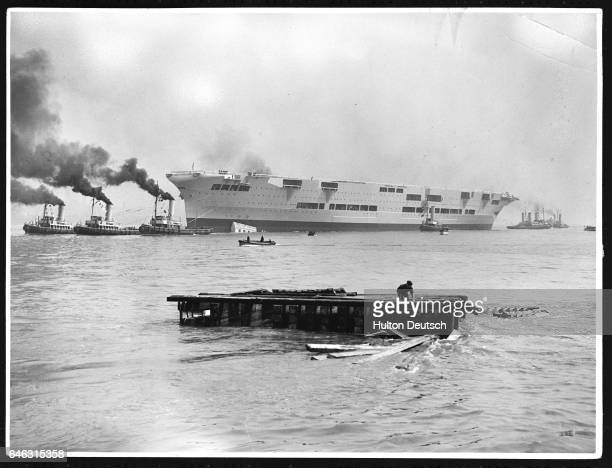 Launch of the British aircraft carrier the 22000 ton HMS Ark Royal which was the second ship of that name in 1937