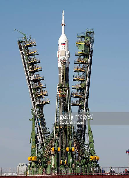 Launch scaffolding is raised into place around the Soyuz rocket.