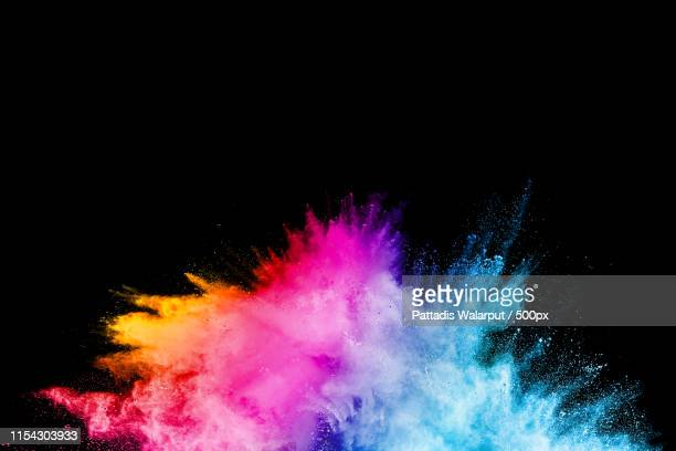 launched colorful powder on black backgroundcolor powder explosioncolorful dust splashing - explosive stock pictures, royalty-free photos & images