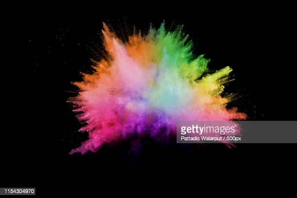 launched colorful powder on black backgroundcolor powder explosioncolorful dust splashing - exploding stock pictures, royalty-free photos & images