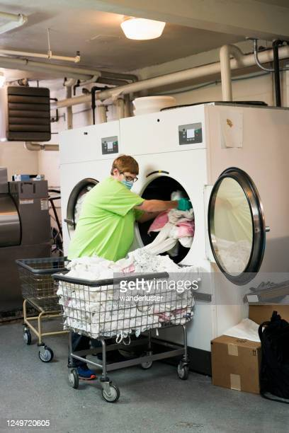 laundering sheets in a nursing facility - infectious disease stock pictures, royalty-free photos & images