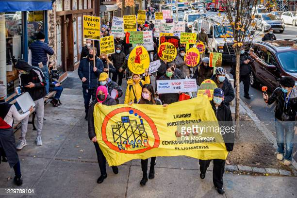 Laundromat workers march holding a banner. On the commemoration of the International Day for the Elimination of Violence against Women, a group of...