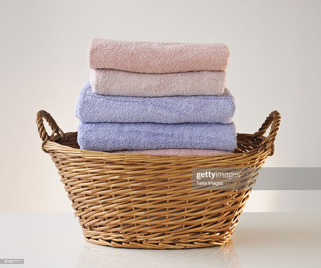 A laundry basket full of towels : Stock Photo