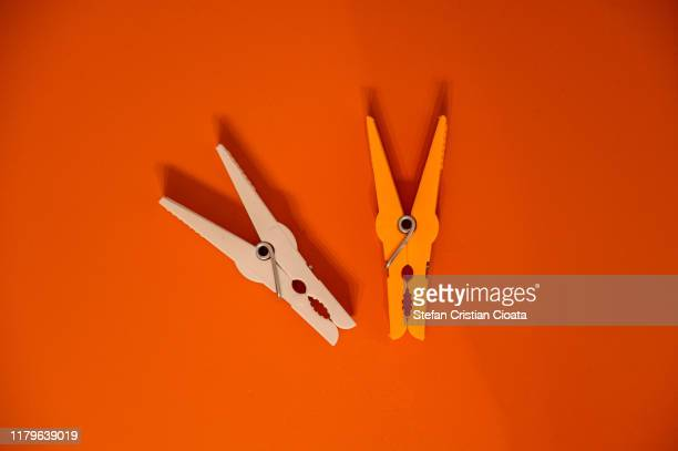 laundry clips on color background - clothespin stock pictures, royalty-free photos & images