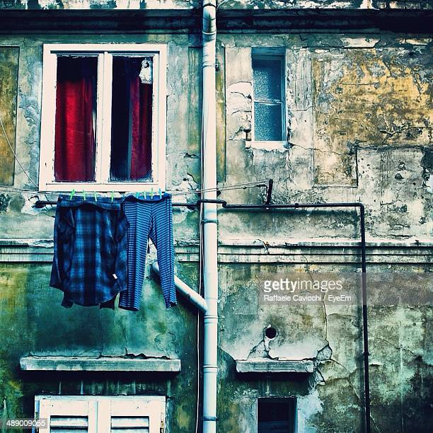 Laundry clothes drying outside house