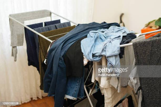 laundry day chaos - drying stock pictures, royalty-free photos & images