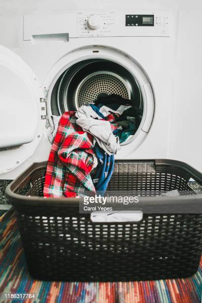 laundry day.drying machine full of colorful clothes - science and technology stock pictures, royalty-free photos & images