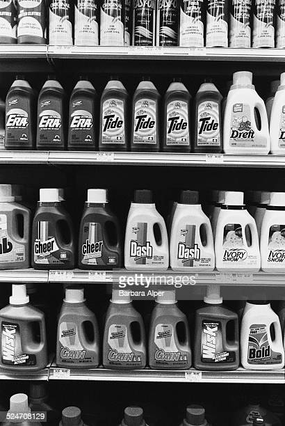 Laundry detergents on a grocery store shelf, USA, April 1994.