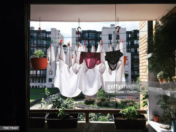 laundry drying on clothesline at balcony - 洗濯物 ストックフォトと画像