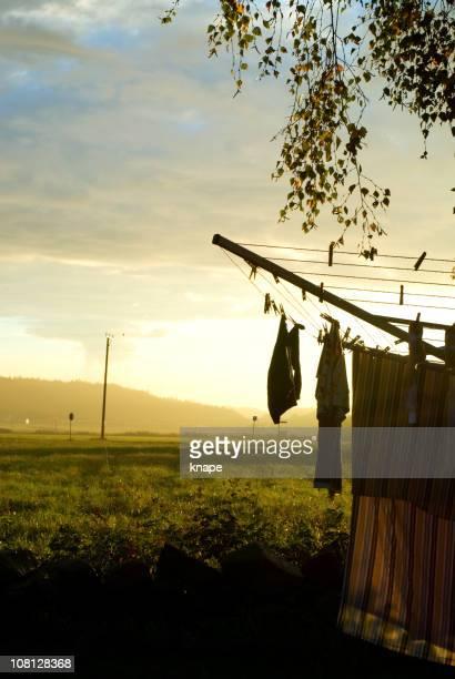 Laundry Drying on Clothesline at Sunrise