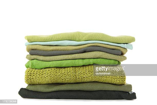 Laundry folded up and stacked in a pile