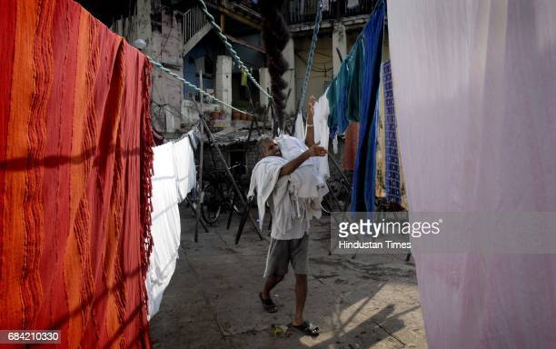 Laundry guy collecting dried clothes at a Dhobi Ghat near Banganga Walkeshwar