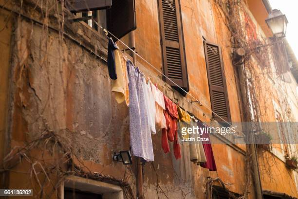 Laundry hanging in the street in Italy
