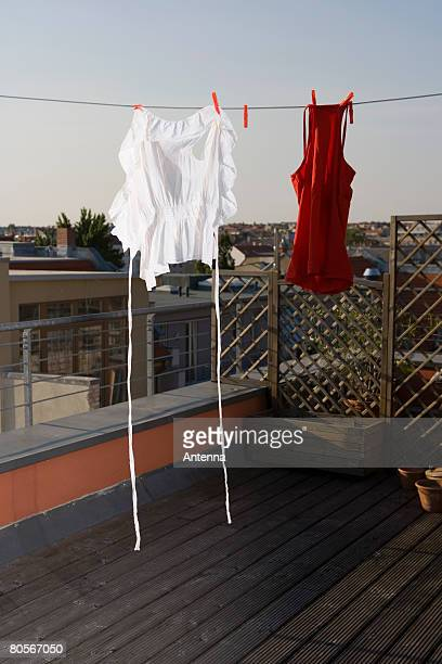 Laundry hanging on a clothesline on a rooftop terrace
