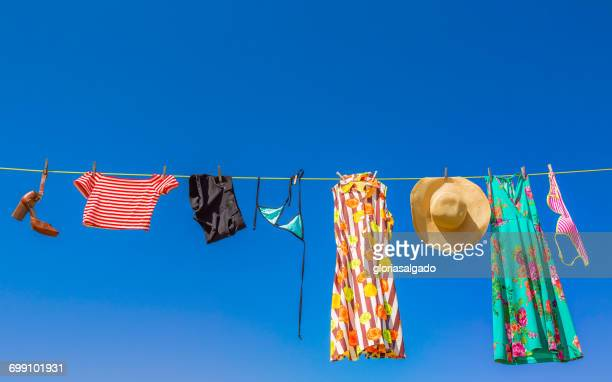 laundry hanging on a washing line - clothesline stock pictures, royalty-free photos & images