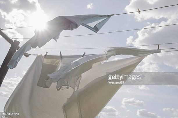 laundry hanging on clothesline in sunlight - 物干し ストックフォトと画像