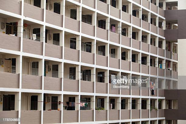 Laundry hangs from clothes lines along a communal corridor at a public housing block in the Commonwealth area of Singapore on Tuesday July 9 2013...
