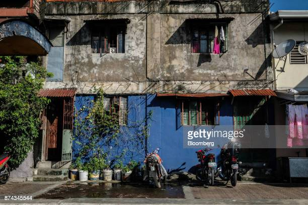 Laundry hangs from the window of lowcost housing in Mandaluyong Metro Manila Philippines on Tuesday Nov 14 2017 Economists are forecasting the...
