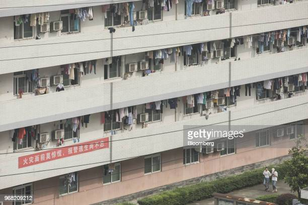 Laundry hangs to dry at an employee dormitory at a Sunny Optical Technology Group factory in Yuyao China on Monday May 28 2018 Founded more than...