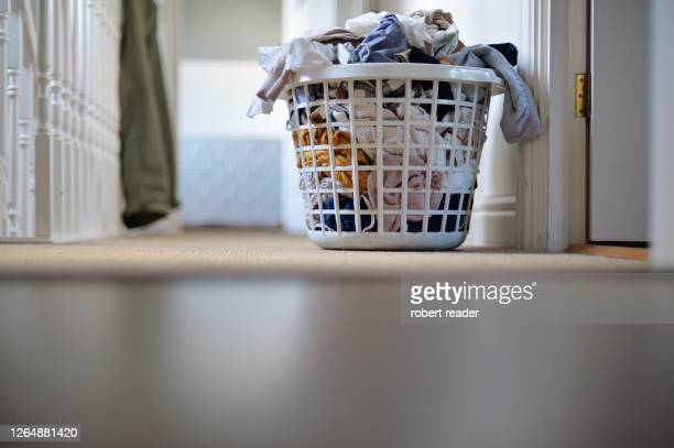 laundry in laundry basket - laundry stock pictures, royalty-free photos & images