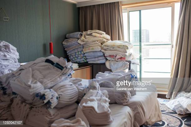 Laundry is piled inside a cabin of a commercial cruise ship that has been transformed into accommodation for the homeless during the pandemic where...