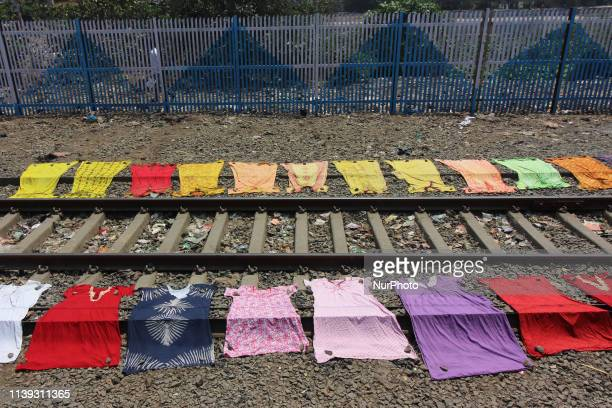 Laundry is seen drying on either side of the railway track in Mumbai India on 25 April 2019