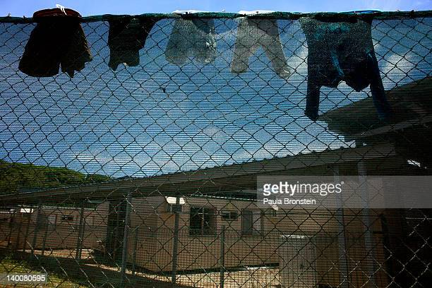 Laundry is seen hanging on a the fence at the Construction camp detention center February 27 2012 on Christmas Island Australia The camp is used for...