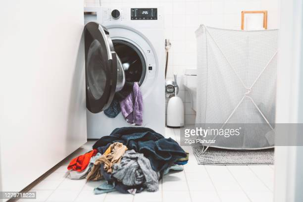 laundry room disaster - tumble dryer stock pictures, royalty-free photos & images