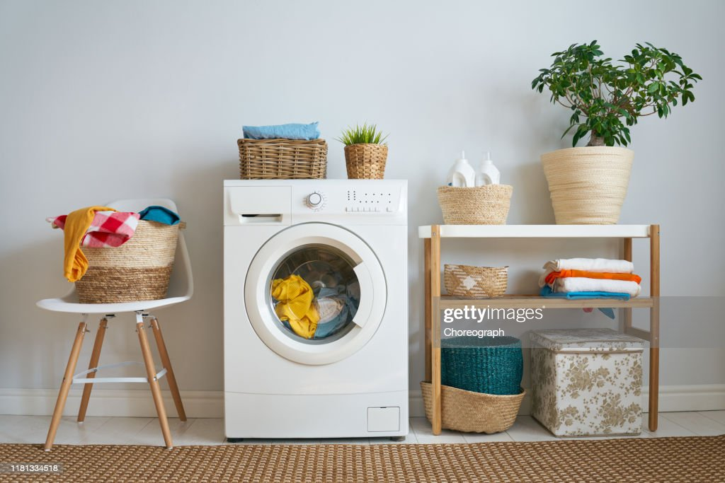 laundry room with a washing machine : Stock Photo