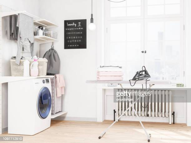 laundry room with washing machine and iron - laundry stock pictures, royalty-free photos & images