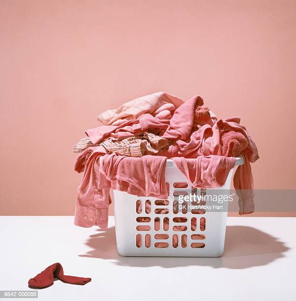laundry turned pink - hamper stock pictures, royalty-free photos & images
