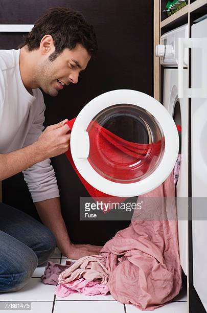 laundry whites ruined by red shirt - red shirt stock pictures, royalty-free photos & images