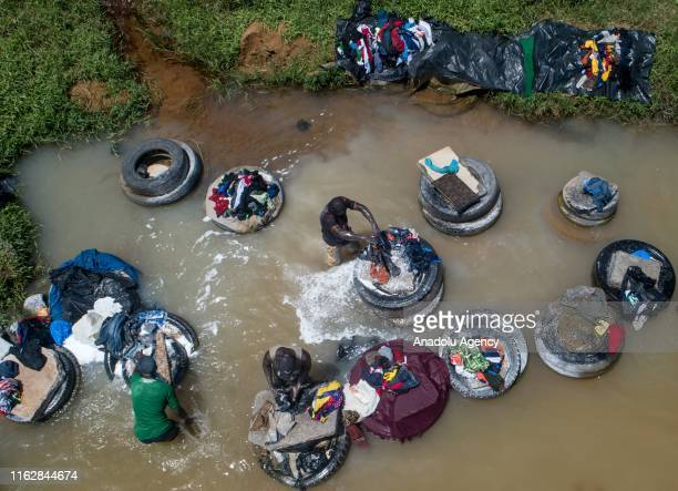 Laundrymen also called 'Fanico' do other people's laundry at the stream in Banco National Park to earn their livings in Abidjan, Ivory Coast on...