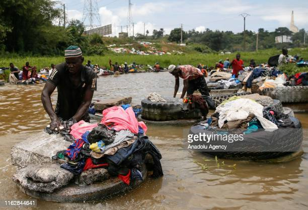 Laundrymen, called 'Fanico', do laundry in Banco River at Banco National Park in Abidjan, Ivory Coast on August 20, 2019. Fanico means simply...