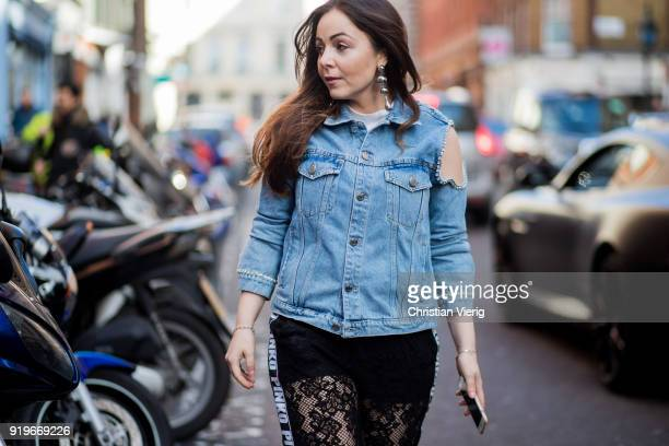 Laura Adrianna Romanin wearing pants Pinko vintage denim jacket with cutouts and studs on the shoulders Gianviot Rossi suede pumps earrings Topshop...