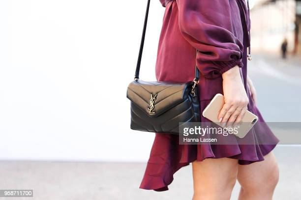 Laura Albertin wearing Zimmerman dress and Yves Saint Laurent clutch during Mercedes-Benz Fashion Week Resort 19 Collections at Carriageworks on May...