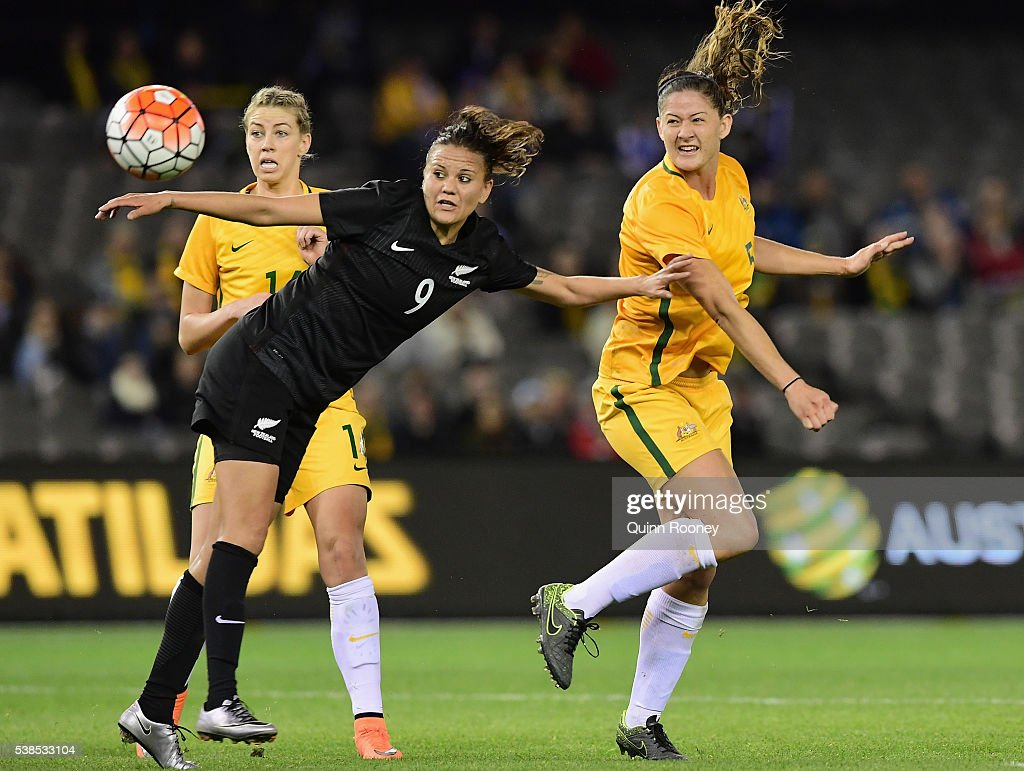 Laura Alleway of Australia heads the ball past Amber Hearn of new Zealand during the Women's International Friendly match between the Australia Matildas and the New Zealand Football Ferns at Etihad Stadium on June 7, 2016 in Melbourne, Australia.