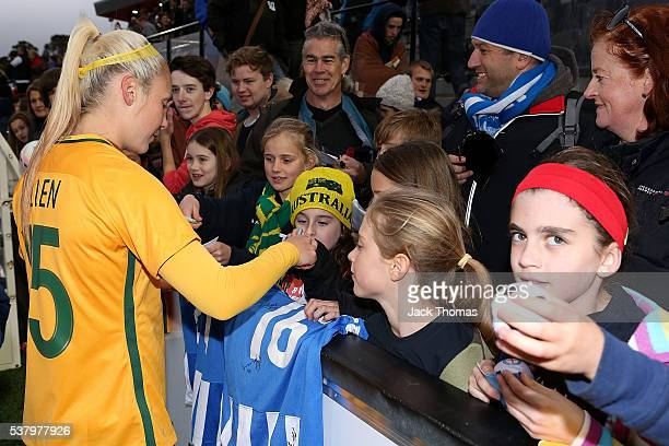 Laura Alleway of Australia signs autographs for fans after the women's international friendly match between the Australian Matildas and the New...