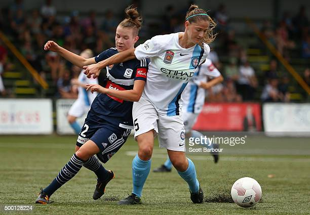 Laura Alleway of City and Whitney Knight of the Victory compete for the ball during the round eight WLeague match between the Melbourne Victory and...
