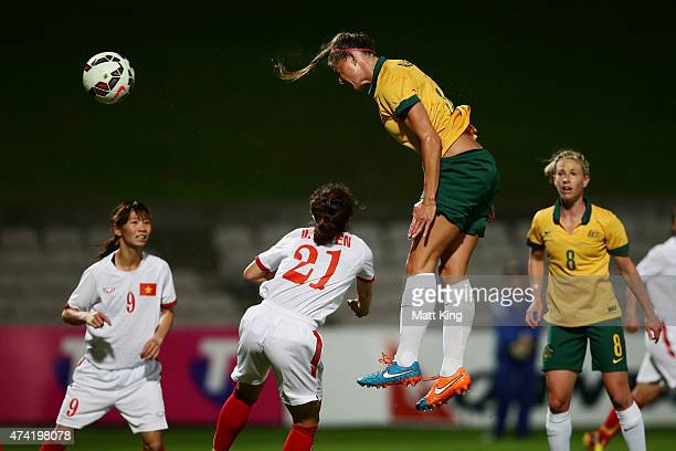 Laura Alleway of the Matildas heads the ball to score a goal during the international women's friendly match between the Australian Matildas and...
