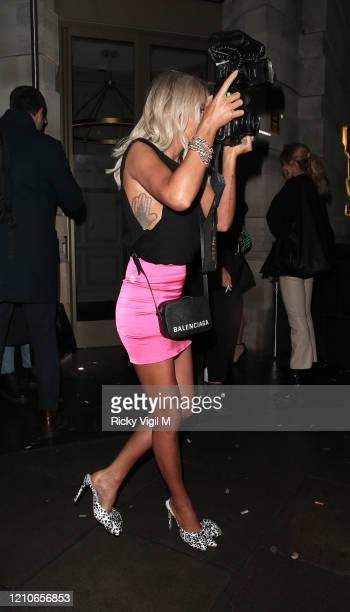 Laura Anderson seen having fun with paparazzi's camera at the launch of Sam Bird's new single in London's Hard Rock Hotel on March 05, 2020 in...