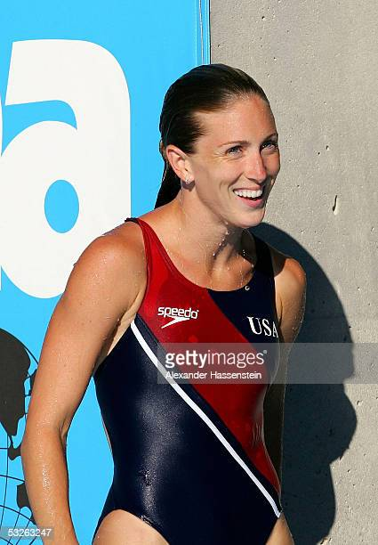Laura Ann Wilkinson of the United States smiles as she gets out of the pool after winning the gold medal in the Women's 10 meter Platform final...