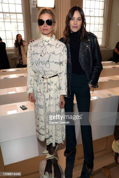 Laura Bailey and Alexa Chung attend the Victoria Beckham show during London Fashion Week February 2020 on February 16 2020 in London England