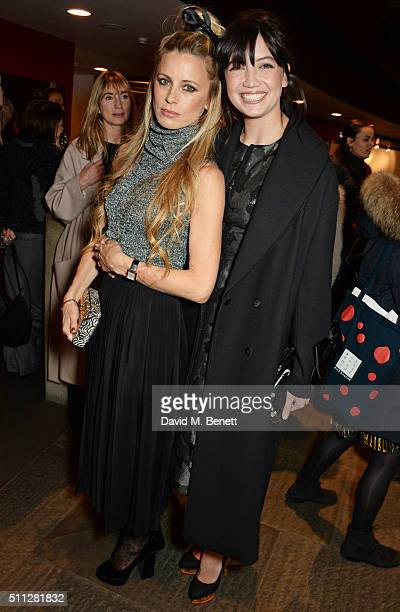 Laura Bailey and Daisy Lowe attend the Charlotte Olympia Fall 16 catwalk show at The Roundhouse on February 19 2016 in London England