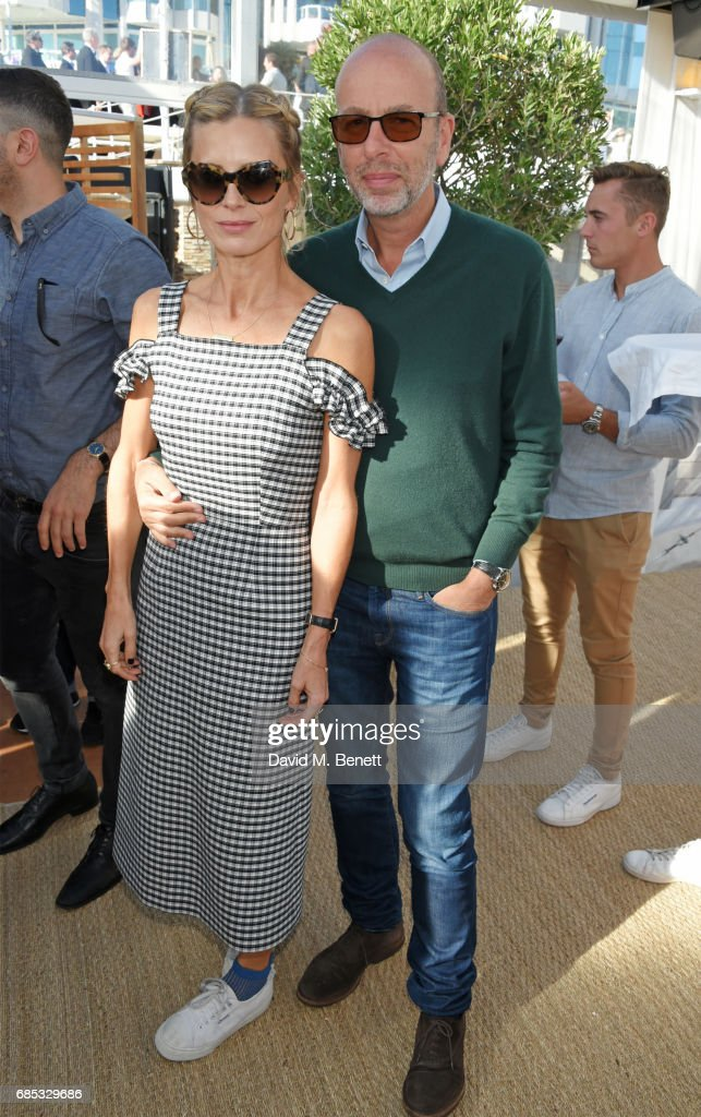 Laura Bailey (L) and Eric Fellner attend Focus Features' 15th Anniversary party at the Cannes Film Festival at Baoli Beach on May 19, 2017 in Cannes, France.