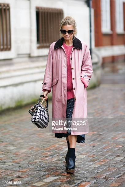 Laura Bailey wears sunglasses a pink long coat a pink wool pullover a skirt black pointy shoes during London Fashion Week Fall Winter 2020 on...