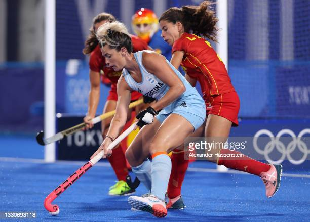 Laura Barrios Navarro of Team Spain and Agustina Albertarrio of Team Argentina battle for the ball during the Women's Preliminary Pool B match...