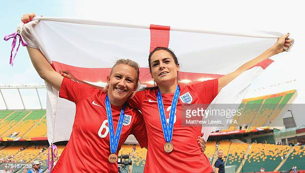 Laura Bassett and Claire Rafferty of England celebrate their teams third place after defeating Germany during the FIFA Women's World Cup 2015 Third...